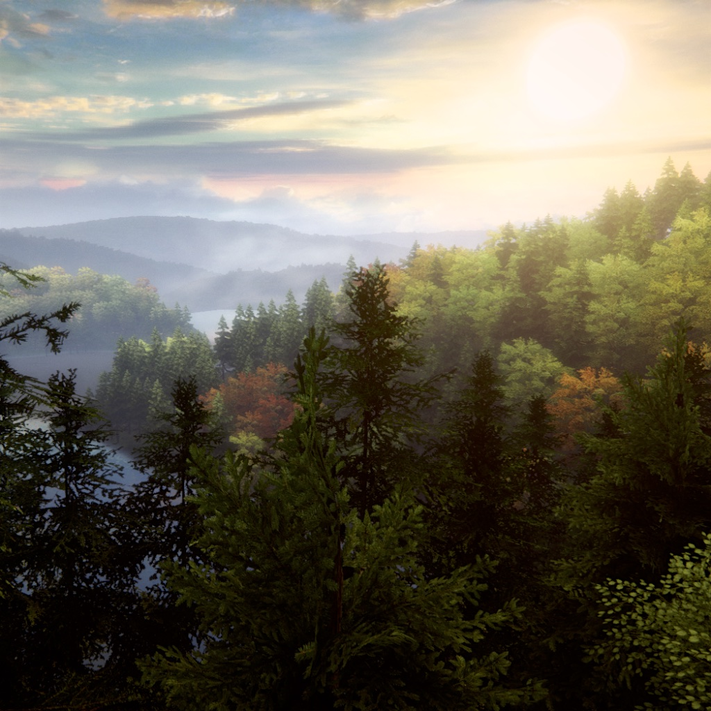 image: looking across forest and lakes into the sunset